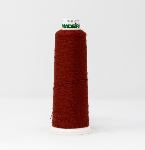 #813-3805 1,100 yard cone of #12 weight Red Brown Burmilana wool embroidery thread