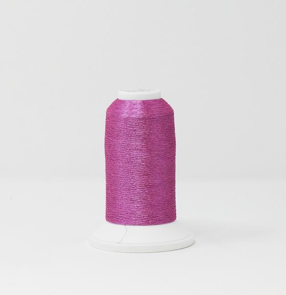 978-4219 2,700 yard cone of Madeira Polyester CR Metallic embroidery thread in Rose Quartz.