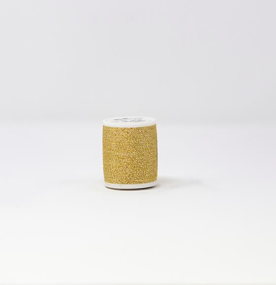 983-24 1,100 yard cone of #30 weight Palladium Yellow Supertwist metallic machine embroidery thread.
