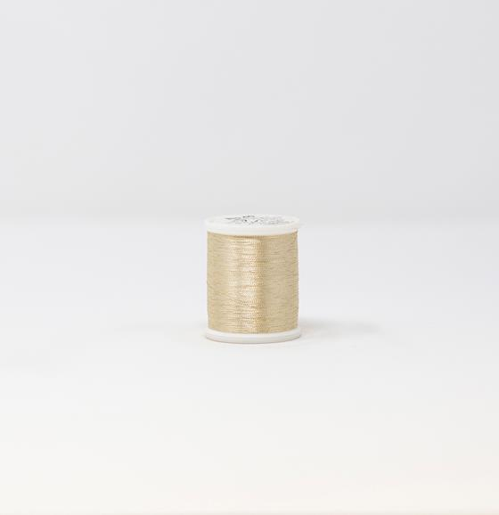 #985-4022 #40 Weight 1,100 yard spool of White Gold Madeira FS Metallic machine embroidery thread.